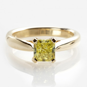 Intense yellow solitaire ring