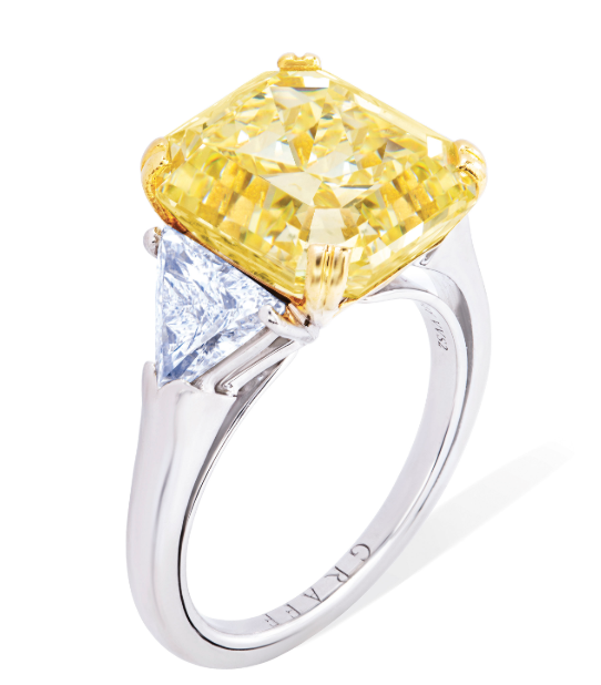 A  8.96 carat fancy intense yellow cut-cornered rectangular step-cut diamond