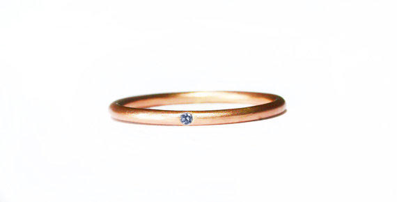 An exquisite blue diamond for a one-of-a-kind wedding band. Langerman Diamonds.