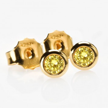 Yellow gold bezel-set stud earrings set with natural intense yellow diamonds. Langerman Diamonds