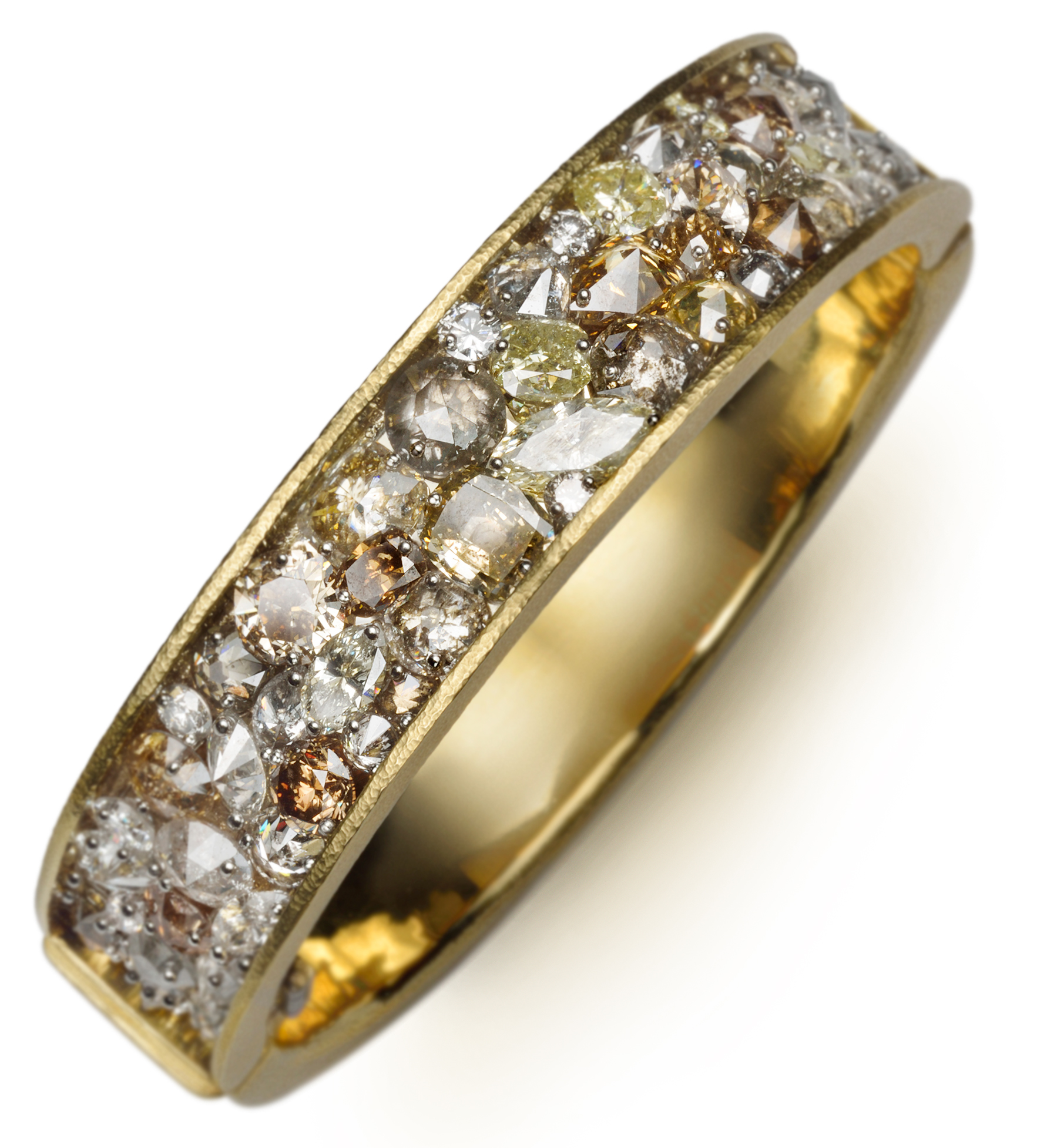 Wide hinged bangle with mixed shaped and colored drilled diamonds set with platinum pins on a layer of 14K white gold wrapped with 18K yellow gold,